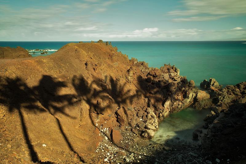 Palm tree shadows and ocean. Hawaii, The Big Island.