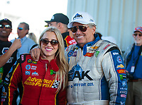 Sep 23, 2018; Madison, IL, USA; NHRA top fuel driver Brittany Force (left) with father John Force during the Midwest Nationals at Gateway Motorsports Park. Mandatory Credit: Mark J. Rebilas-USA TODAY Sports