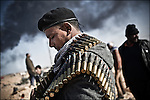 © Remi OCHLIK/IP3 -   RAS LANOUF March 11, 2011 - An opposition fighter with his belt of bullets ..Opposition forces fight troops of colonel Muamar Gadhafi on a road just outside the strategic oil town of Ras Lanouf, Libya..Loyalist forces bombed the rebels from the air and the ground. At least five oppositin fighters were killed and fifteen injured