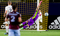 CARSON, CA - SEPTEMBER 19: David Bingham #1 GK of the Los Angeles Galaxy dives for the ball during a game between Colorado Rapids and Los Angeles Galaxy at Dignity Heath Sports Park on September 19, 2020 in Carson, California.