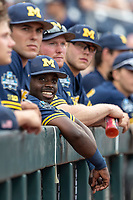 Michigan Wolverines second baseman Ako Thomas (4) in the dugout before Game 6 of the NCAA College World Series against the Florida State Seminoles on June 17, 2019 at TD Ameritrade Park in Omaha, Nebraska. Michigan defeated Florida State 2-0. (Andrew Woolley/Four Seam Images)