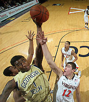 Jan. 22, 2011; Charlottesville, VA, USA; Georgia Tech Yellow Jackets guard Iman Shumpert (1) reaches for the rebound with Virginia Cavaliers guard Joe Harris (12) during the game at the John Paul Jones Arena. Virginia won 72-64. Mandatory Credit: Andrew Shurtleff-US PRESSWIRE