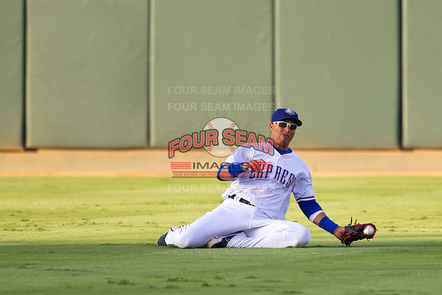 Round Rock Express outfielder Leonys Martin #27 makes a diving catch during the Pacific Coast League baseball game against the Nashville Sounds on August 26th, 2012 at the Dell Diamond in Round Rock, Texas. The Sounds defeated the Express 11-5. (Andrew Woolley/Four Seam Images).