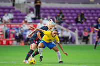 ORLANDO CITY, FL - FEBRUARY 21: Marta #10 of Brazil battles for the ball during a game between Brazil and USWNT at Exploria Stadium on February 21, 2021 in Orlando City, Florida.