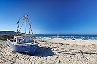 A boat on the beach of Plaka in Naxos island, Greece