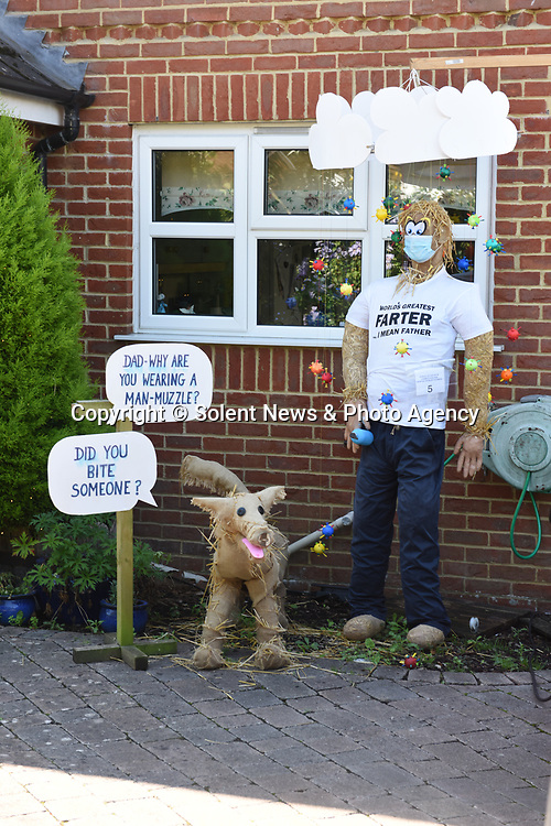 SCARECROW VILLAGE FESTIVAL IN HORDLE, HAMPSHIRE.<br /> <br /> Pictured: Masking for trouble - Entry No.6 for the Hordle Scarecrow compeition.<br /> <br /> Entries this year to a village scarecrow competition seem to have taken a Covid-19 theme, with entries showing Dominic Cummings holding a steering wheel next to an eye chart, key workers stood 2 metres apart and politicians stood at lecterns.<br /> <br /> The pandemic appears to have also played a part in the number of entries this year which is down from twenty last year to eight, but families and businesses have still produced a range of scarecrows for the competition.<br /> <br /> The competition this year is raising money for PATCH - Parents and Teachers in the Community of Hordle, and is organised by the Hordle and District Twinning Association.<br /> <br /> © Ewan Galvin/Solent News & Photo Agency<br /> UK +44 (0) 2380 458800