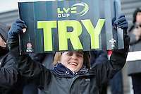 20130310 Copyright onEdition 2013©.Free for editorial use image, please credit: onEdition..A young Sale Sharks fan  celebrates his team scoring during the LV= Cup semi final match between Sale Sharks and Saracens at the Salford City Stadium on Sunday 10th March 2013 (Photo by Rob Munro)..For press contacts contact: Sam Feasey at brandRapport on M: +44 (0)7717 757114 E: SFeasey@brand-rapport.com..If you require a higher resolution image or you have any other onEdition photographic enquiries, please contact onEdition on 0845 900 2 900 or email info@onEdition.com.This image is copyright onEdition 2013©..This image has been supplied by onEdition and must be credited onEdition. The author is asserting his full Moral rights in relation to the publication of this image. Rights for onward transmission of any image or file is not granted or implied. Changing or deleting Copyright information is illegal as specified in the Copyright, Design and Patents Act 1988. If you are in any way unsure of your right to publish this image please contact onEdition on 0845 900 2 900 or email info@onEdition.com