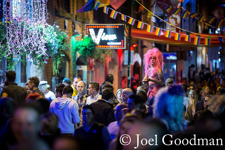 "© Joel Goodman - 07973 332324 . 22/08/2014 .  Manchester , UK . The scene on Canal Street as the evening wears on . Manchester Pride "" Big Weekend "" in Manchester's "" Gay Village "" today ( 22nd August 2014 ) . Photo credit : Joel Goodman"