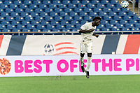 FOXBOROUGH, MA - AUGUST 5: Malick Mbaye #5 of North Carolina FC heads the ball during a game between North Carolina FC and New England Revolution II at Gillette Stadium on August 5, 2021 in Foxborough, Massachusetts.
