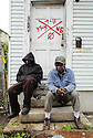 Lee Smith and James Black sit in the nearly abandoned Upper Ninth Ward neighborhood in New Orleans, Fri., Jan. 19, 2007....