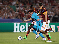 Calcio, Champions League, Gruppo E: Roma vs Barcellona. Roma, stadio Olimpico, 16 settembre 2015.<br /> FC Barcelona's Lionel Messi, center, is challenged by Roma's Antonio Ruediger, left, and Kostas Manolas, during a Champions League, Group E football match between Roma and FC Barcelona, at Rome's Olympic stadium, 16 September 2015.<br /> UPDATE IMAGES PRESS/Isabella Bonotto