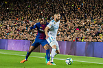 Karim Benzema (R) of Real Madrid competes for the ball with Nelson Cabral Semedo of FC Barcelona during the La Liga 2017-18 match between FC Barcelona and Real Madrid at Camp Nou on May 06 2018 in Barcelona, Spain. Photo by Vicens Gimenez / Power Sport Images