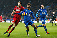 Mike van der Hoorn of Swansea challenges Demarai Gray of Leicester City during the Premier League match between Leicester City and Swansea City at the King Power Stadium, Leicester, England, UK. Saturday 03 February 2018