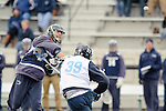 Baltimore- February 4:Jack Forster of Penn States fires through Hopkin's John Kelly during the exhibition between Johns Hopkins and Penn State at Homewood Field on February 04, 2012 in Baltimore, MD.
