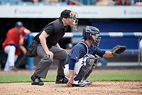 Syracuse Chiefs catcher Tuffy Gosewisch (11) waits to receive a pitch in front of home plate umpire Scott Costello during a game against the Lehigh Valley IronPigs on May 20, 2018 at NBT Bank Stadium in Syracuse, New York.  Lehigh Valley defeated Syracuse 5-2.  (Mike Janes/Four Seam Images)