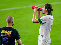 LOS ANGELES, CA - SEPTEMBER 13: Jorge Villafana #4 of the Portland Timbers enjoys some water during a game between Portland Timbers and Los Angeles FC at Banc of California stadium on September 13, 2020 in Los Angeles, California.