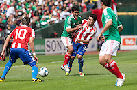 Antonio Naelson Sinha (17) collides with Cristian Riveros (16) facing Edgar Benitez (10) and Pablo Barrera (7). Mexico defeated Paraguay 3-1 at the Oakland Coliseum in Oakland, California on March 26th, 2011.