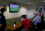 Fans watching the first leg of the Derby v Hull play off semi final in the bar. North Ferriby is 9 miles from Hull. Vanarama National League North, Promotion Final, North Ferriby United v FC Fylde, 14th May 2016.