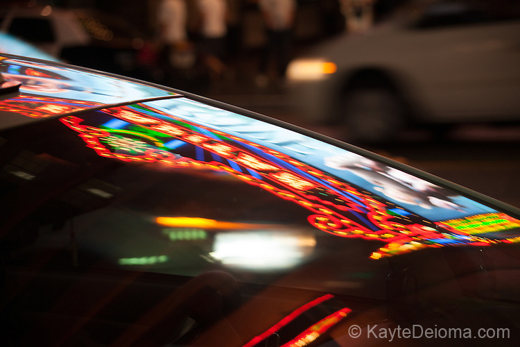 El Capitan Theatre lights reflected in a taxi window on Hollywood Blvd, Hollywood, Los Angeles, CA