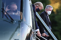 White House Chief of Staff Mark Meadows, right, looks as U.S. President Donald Trump exits Marine One while arriving to Walter Reed National Military Medical Center in Bethesda, Maryland, U.S., on Friday, Oct. 2, 2020. Trump will be treated for Covid-19 after being in isolation at the White House since his diagnosis, which he announced after one of his closest aides had tested positive for coronavirus infection.<br /> Credit: Oliver Contreras/ Pool via CNP/AdMedia
