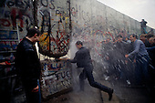 Berlin, Germany<br /> November 11, 1989<br /> <br /> East German police spray water from a water canon on West Germans as they break through the wall near the Brandenburg Gate. The East German government lifted travel and emigration restrictions to the West on November 9, 1989.