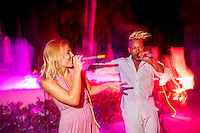 Maldives, Rangali Island. Conrad Hilton Resort. McKenna and Marcel singing at the resort. (MR)