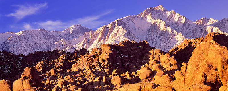 Granite boulders in Alabama Hills with Eastern Sierra Mountains with snow. California.