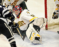 11 February 2011: University of Vermont Catamount goaltender Roxanne Douville, a Freshman from Beloeil, Quebec, gives up a goal to the University of New Hampshire Wildcats at Gutterson Fieldhouse in Burlington, Vermont. The Lady Catamounts defeated the visiting Lady Wildcats 4-2 in Hockey East play. Mandatory Credit: Ed Wolfstein Photo