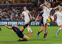 ORLANDO, FL - MARCH 05: Julie Ertz #8 of the United States slides as Steph Houghton #5 of England clears the ball during a game between England and USWNT at Exploria Stadium on March 05, 2020 in Orlando, Florida.