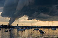 Storm clouds cast a shadow over Newport Harbor and Goat Island Lighthouse