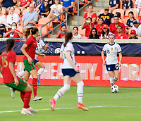 HOUSTON, TX - JUNE 10: Megan Rapinoe #15 of the United States looks to pass the ball during a game between Portugal and USWNT at BBVA Stadium on June 10, 2021 in Houston, Texas.