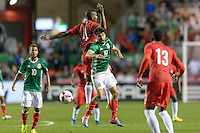 Bridgeview, IL, USA - Tuesday, October 11, 2016: Panama defender Fidel Escobar (4) and Mexico forward Oribe Peralta (19) during an international friendly soccer match between Mexico and Panama at Toyota Park. Mexico won 1-0.