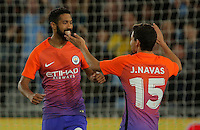 Dael Clichy of Manchester City (C) celebrates his opening goal with team mate Jesus Navas (R) during the EFL Cup Third Round match between Swansea City and Manchester City at The Liberty Stadium in Swansea, Wales, UK. Wednesday 21 September.