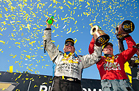Sep 2, 2019; Clermont, IN, USA; NHRA funny car driver John Force (left) and top fuel driver Doug Kalitta celebrate after winning the US Nationals at Lucas Oil Raceway. Mandatory Credit: Mark J. Rebilas-USA TODAY Sports