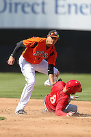 Bowie BaySox shortstop Manny Machado #3 tags Jeff Kobernus #8 sliding in safely during a game against the Harrisburg Senators at Prince George's Stadium on April 8, 2012 in Bowie, Maryland.  Harrisburg defeated Bowie 5-2.  (Mike Janes/Four Seam Images)