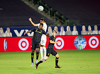CARSON, CA - SEPTEMBER 06: Joe Corona #15 of the Los Angeles Galaxy and Jose Cifuentes #11 of LAFC battle in the air for a ball during a game between Los Angeles FC and Los Angeles Galaxy at Dignity Health Sports Park on September 06, 2020 in Carson, California.