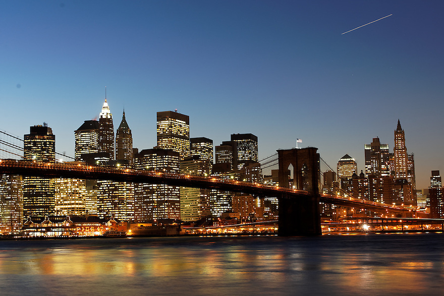 New York City and lower Manhattan framed by the Brooklyn Bridge.