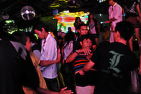 People dance under the influence of drugs in night-clubs in Ruili, China. Chinese-Burmese gangs control drugs that are freely available clubs in the area. The drugs come from Burma....PHOTO BY SINOPIX