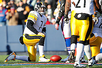 ORCHARD PARK, NY - NOVEMBER 28: Ben Roethlisberger #7 of the Pittsburgh Steelers kneels after being sacked by the Buffalo Bills during the game on November 28, 2010 at Ralph Wilson Stadium in Orchard Park, New York.  (Photo by Jared Wickerham/Getty Images)