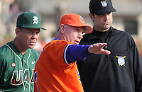 Head coach Jack Leggett (7) of the Clemson Tigers points out grounds rules tod head coach Brian Shoop of the University of Alabama-Birmingham on Feb. 17, 2012, at Doug Kingsmore Stadium in Clemson, South Carolina. (Tom Priddy/Four Seam Images)