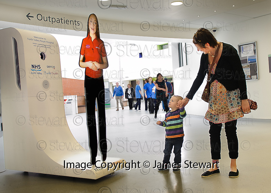 Simon Bingham (2) and mum Rosemary, from Alloa take a look at. and listen to, EVA, the Electronic Virtual Assistant at  Forth Valley Royal Hospital in Larbert.