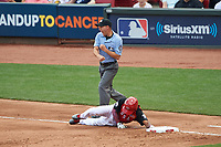 Umpire Dan Merzel calls Team USA base runner (ground) Tony Kemp out after getting picked off during the MLB All-Star Futures Game on July 12, 2015 at Great American Ball Park in Cincinnati, Ohio.  (Mike Janes/Four Seam Images)