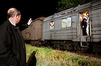American-Ukrainian physicist Igor Bolshinsky waves goodbye to an armoured train carrying highly enriched uranium (HEU) in Almaty from where it will travel to Russia for downgrading. The removal of Kazakhstan's HEU is part of the U.S. Global Threat Reduction Initiative (GTRI) where Bolshinsky works which tries to secure nuclear material around the world to prevent their misuse.