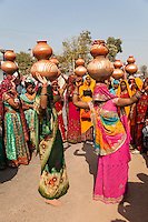 Rajasthan, India.  Women Dancing with Pots on their Heads at a Pre-wedding Celebration.