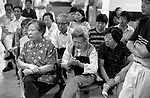 China, Shanghai.  There are said to be 60 million shareholders in China getting a direct taste of capitalism.   Here, at the end of the trading day, enthusiastic punters are briefed on the day's stock market movements by their broker. For the elderly and workers who have been laid off, the stock exchange provides not only a potential source of income but a