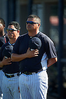 GCL Yankees East manager Raul Dominguez during the national anthem before a game against the GCL Yankees West on August 3, 2016 at the Yankees Complex in Tampa, Florida.  GCL Yankees East defeated GCL Yankees West 12-2.  (Mike Janes/Four Seam Images)