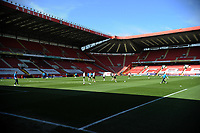 24th April 2021; The Valley, London, England; English Football League One Football, Charlton Athletic versus Peterborough United; The teams warm up in the bright London sunlight before the game