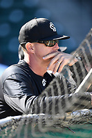 Head coach Mark Kingston (17) of the South Carolina Gamecocks watches from behind the cage as his team takes batting practice prior to the Reedy River Rivalry game against the Clemson Tigers on Saturday, March 3, 2018, at Fluor Field at the West End in Greenville, South Carolina. Clemson won, 5-1. (Tom Priddy/Four Seam Images)