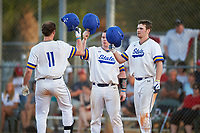 South Dakota State Jackrabbits Landon Badger (11) greeted at home by Ryan McDonald (center) and Colton Cox (right) after hitting a home run during a game against the Northeastern Huskies on February 23, 2019 at North Charlotte Regional Park in Port Charlotte, Florida.  Northeastern defeated South Dakota State 12-9.  (Mike Janes/Four Seam Images)