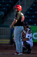 Devin Caldwell (10) of the Southern Illinois University- Edwardsville Cougars watches for the batting signals during a game against the Missouri State Bears at Hammons Field on March 10, 2012 in Springfield, Missouri. (David Welker / Four Seam Images)